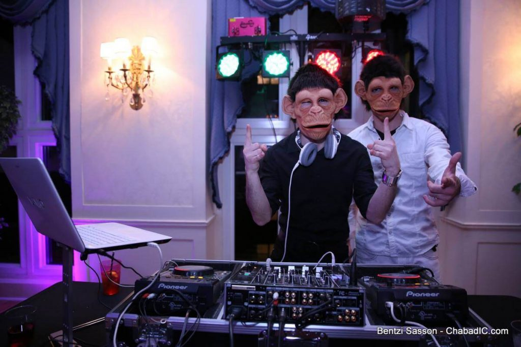 DJ Baturo & MC Josh going bananas at a Purim party in Liederkranz Ballroom