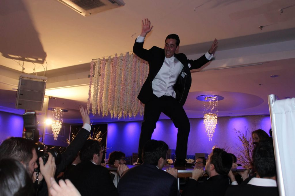 When the groom dance on the table being held by guests, thats when you know the TRUST GAME begins!