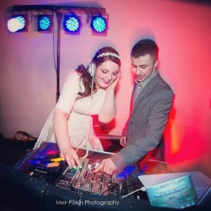 Bride being a DJ